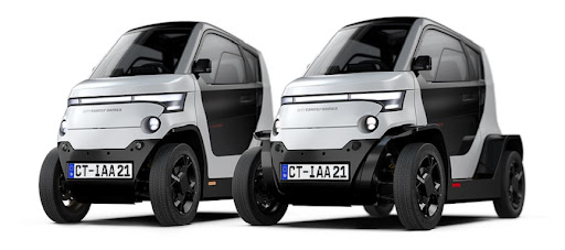 The City Transformer with its wheels narrowed for parking (left) and widened for driving (right).