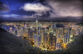 Photo: Hong Kong from the peak on a summer's night  After I got back to Hong Kong after a day in Shenzen, I was hot and sweaty and in the sort of meeting clothes that aren't great for being hot and sweaty in. But, everything about Hong Kong was still awesome and I had too look hard for things to complain about. The sun was setting, and I made it up to The Peak just in time for a shot.  from the blog at www.stuckincustoms.com