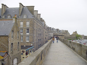 Photo: The city buildings rise well above the walls. It is said that the town merchants did this purposely to advertise their prosperity, and their sense of security inside the fortifications. The defensive walls were originally from the 12th century, and were expanded and improved by Vauban at the time of Louis XIV.