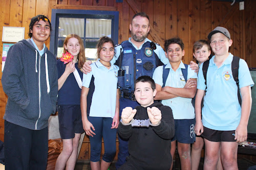 Senior Constable Will Kirby was popular with the kids at the Youth Shack open day/Youth Insearch opening last Wednesday evening. He is pictured here with, back, Blake Boney, Rachel Jones, Lakeiya Dennis, Malik Dennis, Jye Anderson and Ashton Smith, front, Neeve Mor.