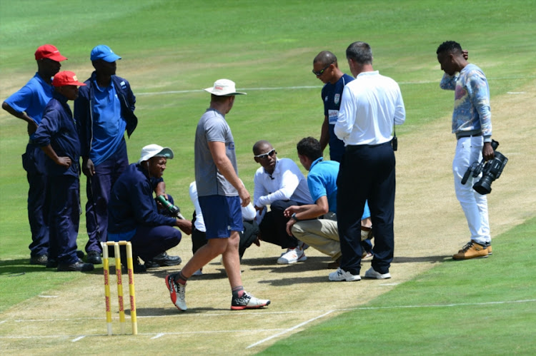 Umpire, Lubabalo Gcuma and Umpire, Dennis Smith look at the pitch during day 1 of the Sunfoil Series match between Multiply Titans and BuildNAT Cape Cobras at SuperSport Park on January 26, 2017 in Pretoria, South Africa.