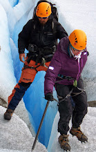 Photo: Jane gets help stepping over a deep crevasse