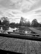 Photo: Black and white photo of wooden docks on a pond at Eastwood Park in Dayton, Ohio.