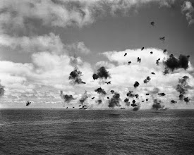 Photo: June 4, 1942: The U.S. aircraft carrier Yorktown, left, and the other fighting ships of a United States task force in the Pacific, throw up an umbrella of anti-aircraft fire to beat off a squadron of Japanese torpedo planes attacking the carrier during the battle of Midway. (AP Photo)