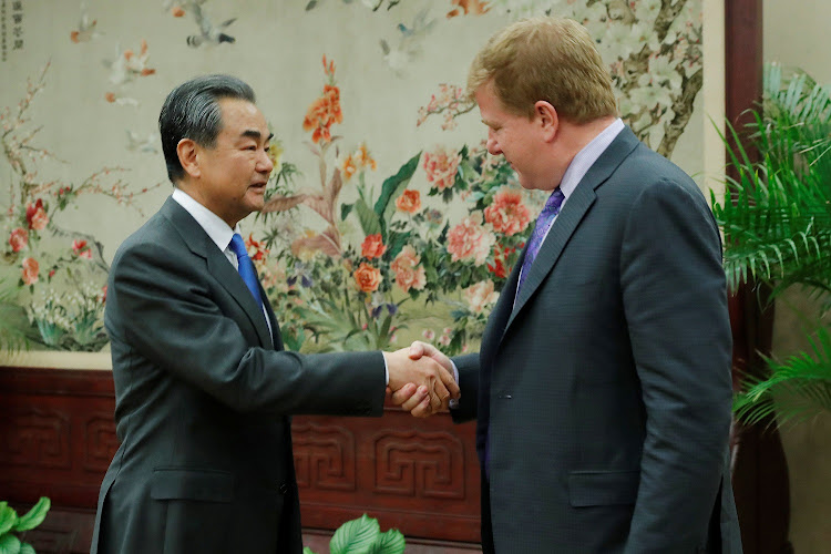 Chinese State Councilor and Foreign Minister Wang Yi shakes hands with Myron Brilliant, executive vice president and head of International Affairs at the U.S. Chamber of Commerce, ahead of a meeting at the Ministry of Foreign Affairs in Beijing, China February 19, 2019. Picture: WU HONG / REUTERS