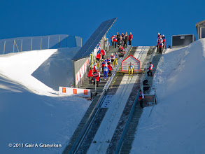 Photo: Ski flying Vikersund HS225 - One of the trial jumpers (Stian Skinnes) ready at the top during testing of the hill, before the World Cup competition started later the same day