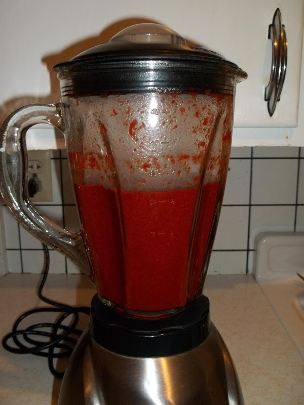 Place chilies in blender, blend until smooth. (sauce will be thick) Put blended chilies...