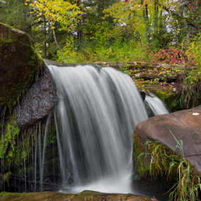 Autumn Plunge by Kenneth Keifer - Landscapes Waterscapes ( stream, colorful, rocky, waterfall, moss, flow, blur, remote, landscape, leaves, upper, nature, autumn, foliage, creek, splashes, long exposure, wet, rocks, ojibwa, water, boulders, flowing, colors, midwest, cliff, forest, scenic, plunging, o kun de kun, plunge, woods, rural, maple, upper peninsula, blurred, michigan, splashing, cascade, fall, o kun de kun falls, baltimore river, trees, cataract, ojibway, october, whitewater, upper falls )