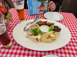 """Photo: """"Beer Snacks,"""" as they are called in Riga:  cheeses, grey peas, peanuts, and garlic toasties"""