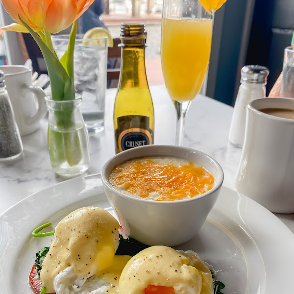 Breadless eggs benny with cheese grits