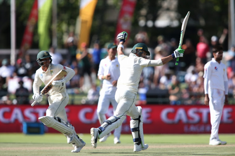South African captain Faf du Plessis celebrates reaching his century during day 2 of the 2nd Castle Lager Test match between South Africa and Pakistan at PPC Newlands on January 04, 2019 in Cape Town, South Africa.
