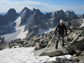 Photo: Kevin on the summit ridge, 10 minutes of sleep catching up with him.