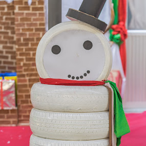 A cute snowman. by John Greene - City,  Street & Park  Neighborhoods ( car tires, snowman, art, white, painted, artistic, john greene )