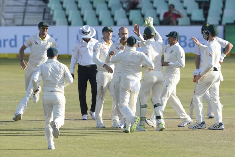 Nathan Lyon of Australia celebrates the wicket of Quinton de Kock of the Proteas with his team mates during day 2 of the 1st Sunfoil Test match between South Africa and Australia at Sahara Stadium Kingsmead on March 02, 2018 in Durban