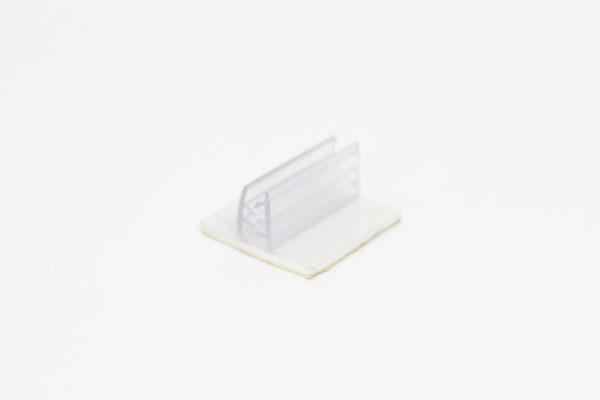 pinza plástica sujeta gráficas de 2,5 x 1 cm con adhesivo espumoso