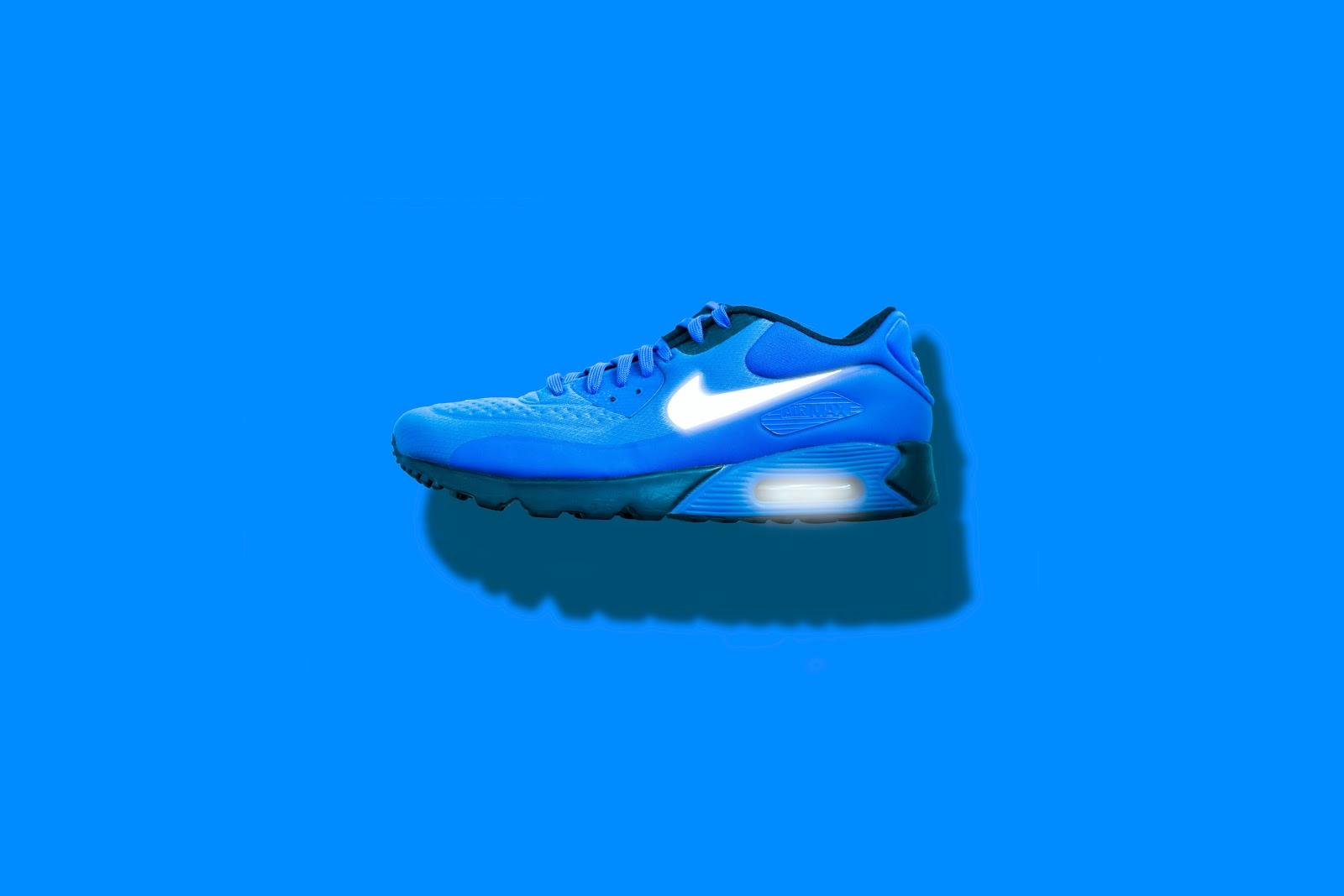 Blue Nike Shoe over blue background