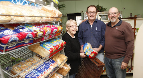 Full circle: Almost 32 years after his first delivery to Thomas', Billy Watson, centre, makes his final bread delivery to Graham and Sue Thomas' store.