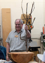 Photo: Mark uses his Charlie Brown tree to show how and where to cut on a tree.  He also used the 1/2 a log below it to talk about cuts better for your saw.