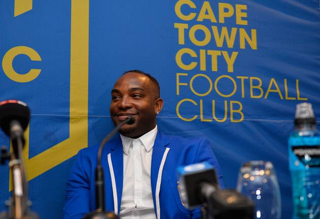 Newly appointed Cape Town City FC head coach Benni McCarthy smiles during his unveiling press conference at Radisson Blu Hotel on June 13, 2017 in Cape Town, South Africa.