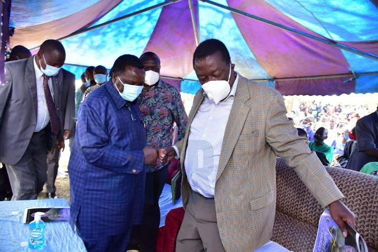 ANC party leader Musalia Mudavadi with COTU sec.gen. Francis Atwoli at the funeral of the late Francis Chogo in North Maragoli in vihiga county.