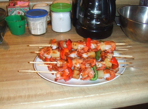 Take a basting brush,brush each skewer with sauce. place in broiler,and cook 3 min....