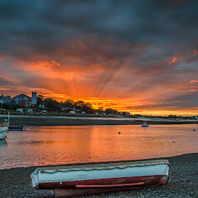 Channel sunrays by Graham Kidd - Landscapes Waterscapes ( water, sunset, boats, sunrays, dusk )