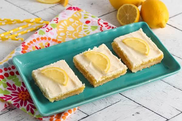 Melt In Your Mouth Lemon Bars On A Serving Platter.