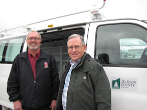 Photo: Jim Flippo of DSU Peterbilt and Mike James, fleet manager for Jackson County, worked to make the county's new Chevy cargo van more efficient by repositioning the CNG tank.
