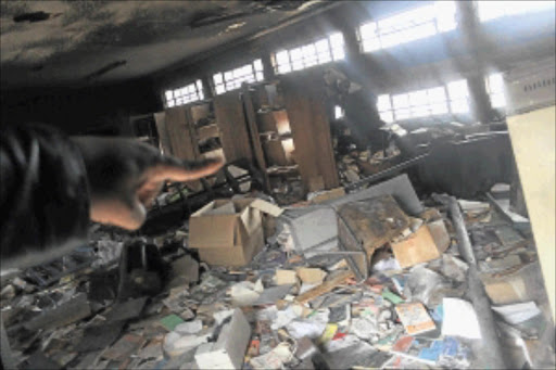 DESTROYED: Soweto's Bopasenatla Secondary School's storeroom, full of outdated textbooks, some unopened, caught fire on Tuesday.        PHOTO: BAFANA MAHLANGU