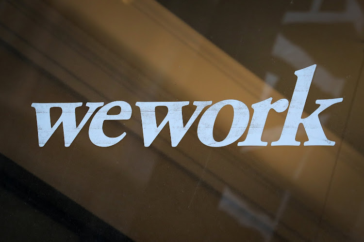 The WeWork logo is displayed on the entrance of a co-working space in New York City, New York US.
