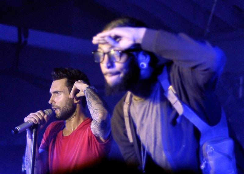 Photo: LOS ANGELES, CA - NOVEMBER 16: Singers Adam Levine of Maroon 5 and Travie McCoy perform onstage during the launch of Google Music hosted by T-Mobile at Mr. Brainwash Studio on November 16, 2011 in Los Angeles, California. (Photo by Jerod Harris/Getty Images for T-Mobile) *** Local Caption *** Travie McCoy; Adam Levine 2011 Getty Images