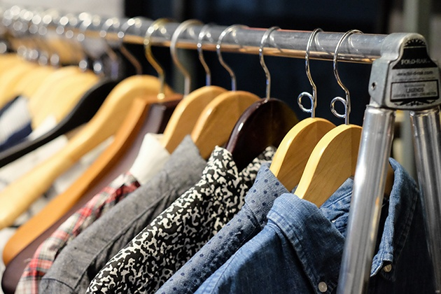 an image of clothes hanging on a rack