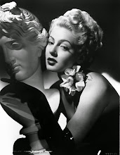 Photo: Hurrell often used statues and flowers to underline the aestheticism of the glamour portrait.  In this case, Lana Turner's face is matched and offset by the statute.