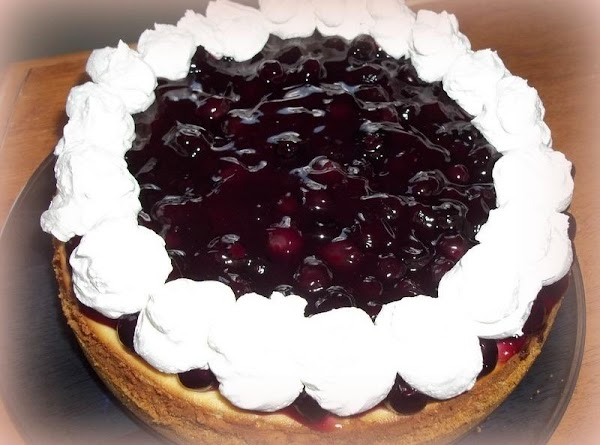 When ready to cut cheesecake, spoon over individual pieces or cover the cheesecake with...