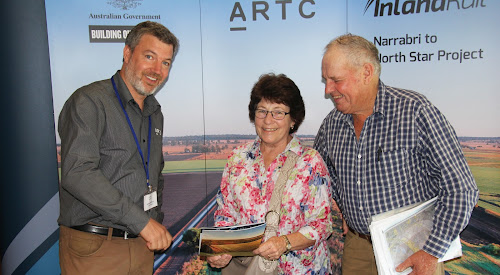 Inland Rail Narrabri to North Star project manager Benjamin Wells with landowners Janet and Peter Dampney, whose property can be seen on the board behind, in between Mr Wells and Mrs Dampney.