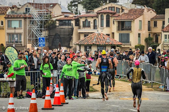 Photo: Athletes run toward T1 after exiting the swim at the 2014 Escape from Alcatraz Triathlon on June 1, 2014 in San Francisco, CA