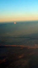 Photo: Moonrise as we prepare to land in Reykjavik at 11:00pm