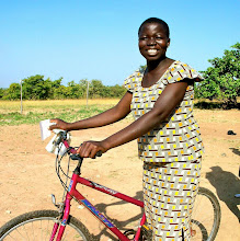 Photo: Abubakari Nsheratu is from the village Dupari where she is a student.  She goes to a school about 5 km from Dupari, which normally it takes her an hour to walk.