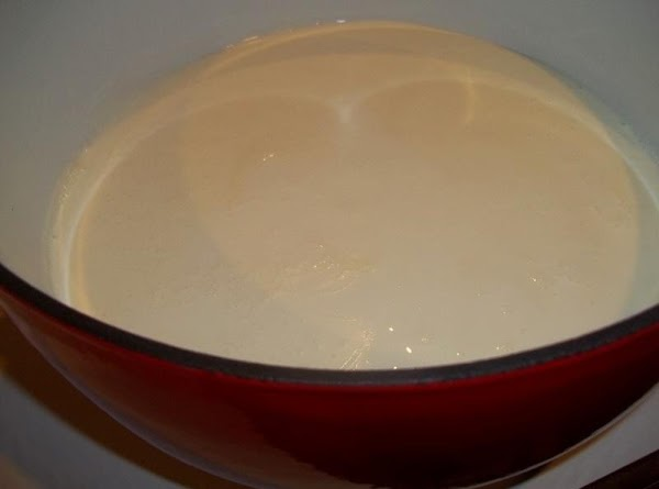 While the pasta is cooking, heat the half-and-half in a large saucepan over medium...