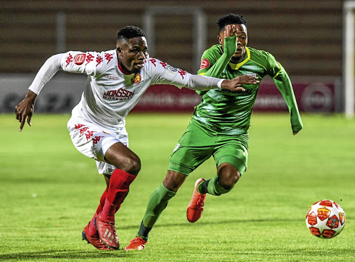 Goodman Mosele of Baroka clashes with Highlands Park's Sello Motsepe. /Gallo Images / Sydney Seshibedi