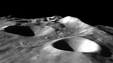 Photo: An unnamed pair of deep craters and high mountain peaks on the lunar far side.