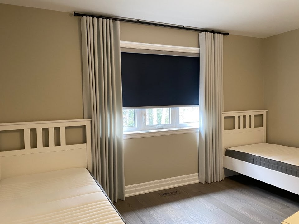 Bedroom Blackout Roller Shade paired with Wave Fold Room Darkening Drapery Ceiling Mounted