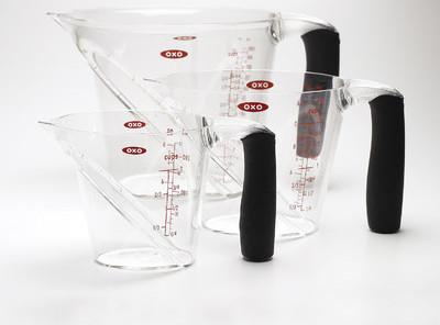 Open the cans of veggies and drain the liquid into the largest measuring cup...