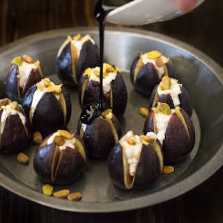 Warm Figs With Goat Cheese, Pistachios And Balsamic Glaze.