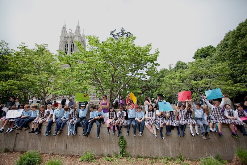 Photo: Boston College's Commencement for the class of 2012. The break-out ceremony on O'Neill Plaza for the Lynch School of Education. Classes from the St. Columbkille Partnership School were there to support their LSOE teachers.