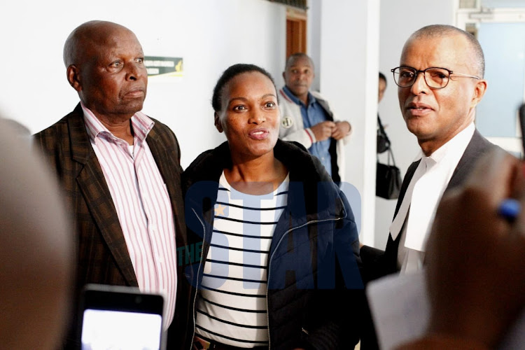 Sarah Wairimu, her father Japheth and lawyer Philip Murgor at a Mililamani law court on Firday, October 11,2019