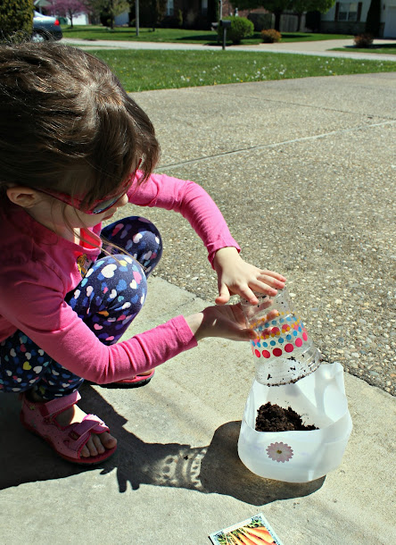 Gardening with kids - fill the milk jugs with dirt to plant seeds or starter plants