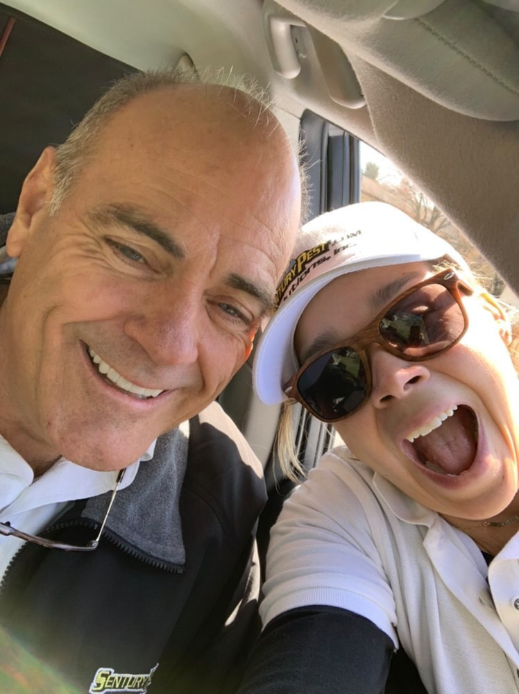 Melissa and her former boss smiling for a selfie.
