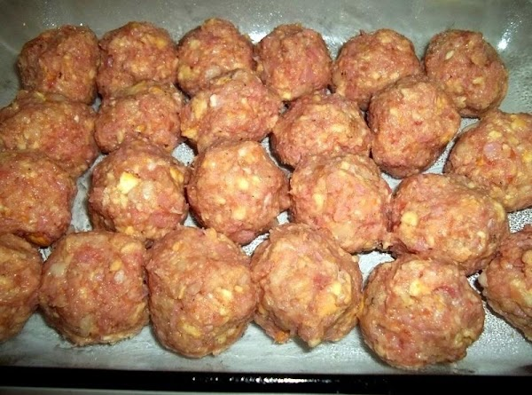 Make balls about the size of a golf ball and place in prepared dish....