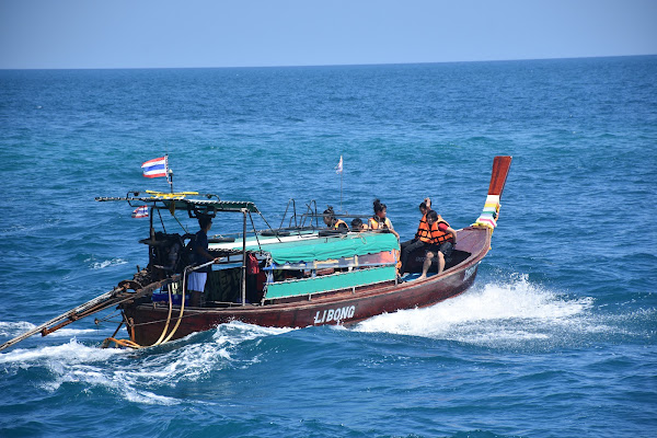Cruise by traditional longtail boat to the southern islands of Lanta